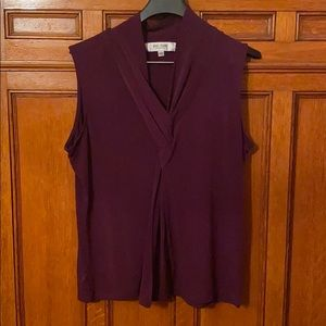 Wine colored blouse with front twist detail